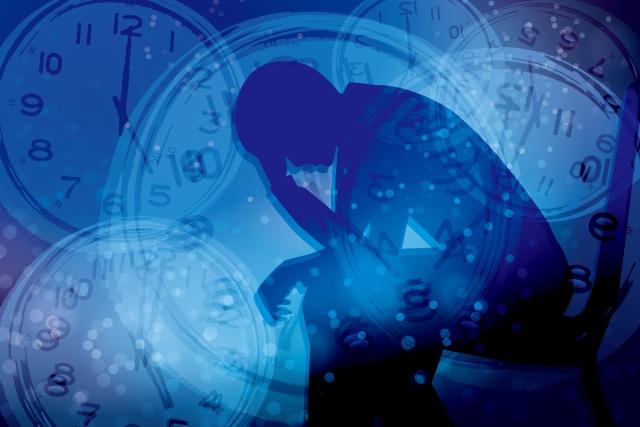 ストレスを抱える男性と時間-青背景